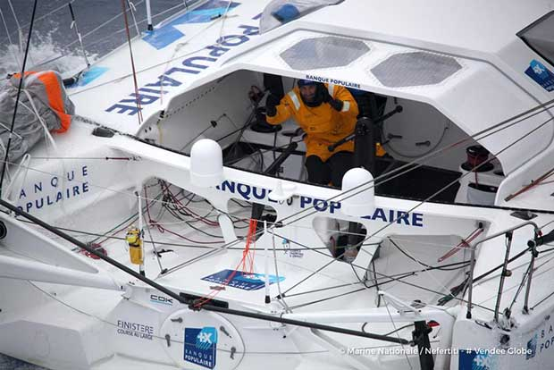 Banque Populaire VIII, skipper Armel Le Cleac'h (FRA), off the Kerguelen Islands, flown over by the National French Marine Nivose Frigate, during the Vendee Globe, solo sailing race around the world, on November 30th, 2016 Marine Nationale / Nefertiti / Vendee Globe vendeeglobe.org