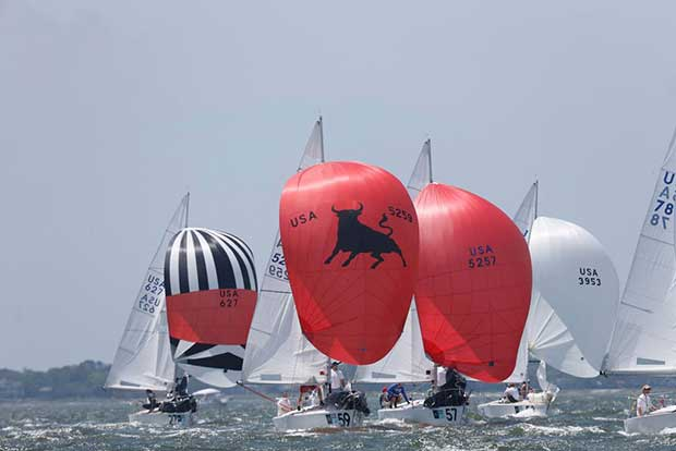 Bright colors and beautiful shapes bely the athleticism and smarts required to get a J/24 around the track in big breeze during Day 2 of Sperry Charleston Race Week 2017. © Tim Wilkes / Charleston Race Week