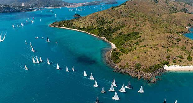 Part of a huge fleet of yachts competing at Audi Hamilton Island Race Week heads away from the island and towards the Whitsunday Passage. © Andrea Francolini http://www.afrancolini.com/