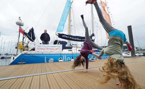Friends Georgie and Effie showing off their cartwheeling skills along the pontoon during the open boat session in Inverness Marina. The pair raised over £1400 cartwheeling across every beach on mainland Orkney. © Ellen MacArthur Cancer Trust