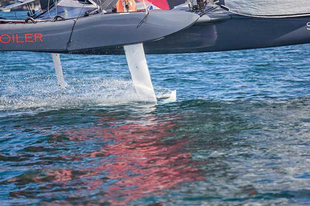 Foil deployed and easily carving it up at over 20 knots. - SuperFoiler Grand Prix © John Curnow