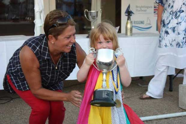 Sue Bouckley of Learning and Skills Solutions presents three year old Josie Heppell with her Youngest Crew trophy © Mandy Bines