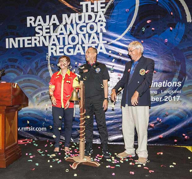 Ringing the bell. Elizabeth Wong, State Executive Councillor; Dato Seri Aziz, Minister of Tourism and Culture; Jeff Harris, Commodore RSYC. 2017 Raja Muda Selangor International Regatta. Guy Nowell / RMSIR