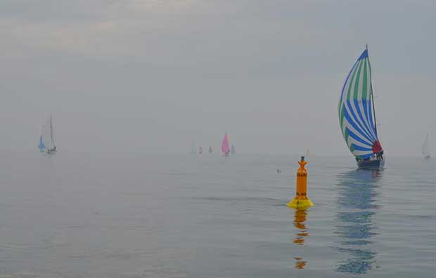 The fleet in very light winds during the Poole Yacht Racing Association Pursuit Race - photo © Roger Bond