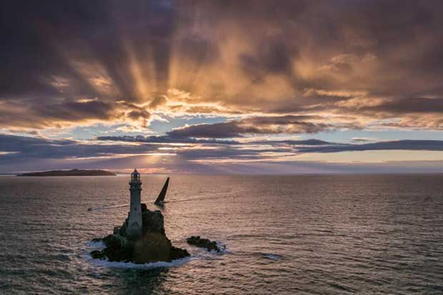 Nikata passes the Fastnet Rock at sunrise in the 2017 edition of the race - photo © Rolex / Carlo Borlenghi