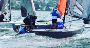 Sam Tiedemann hangs onto the transom of the SB20 Export Roo after falling overboar - Crown Series Bellerive Regatta - photo © Steve Catchpool