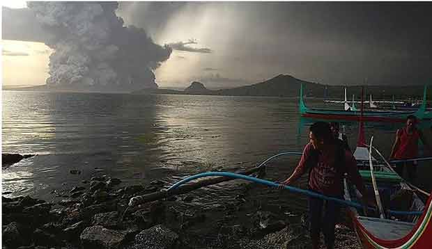 Evacuations on the island were underway after Taal Volcano spews pillars of ash and steam Photo: ABS-CBN News