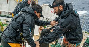 Michael Holmes and Lizzie Cave grinding while raining - The Clipper Race Leg 5 - Race 7, Day 7 - photo © Maeva Bardy