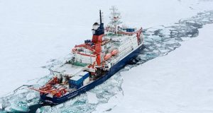 An international team of scientists aboard the U.S. Coast Guard Cutter Healy and the German research icebreaker Polarstern met at the North Pole in 2015 to survey elements in the Arctic Ocean. (Photo by Stefan Hendricks, Alfred Wegener Institute)