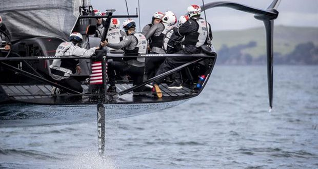 Sean Clarkson (No.9) looks up at the mainsail as American Magic's first AC75, Defiant, goes through its paces on the Hauraki Gulf. © Will Ricketson