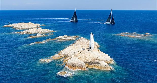 The Monaci lighthouse and rocks form one the most famous course marks at the Maxi Yacht Rolex Cup - photo © Carlo Borlenghi